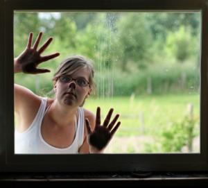 136560242-woman-peeking-in-window-gettyimages