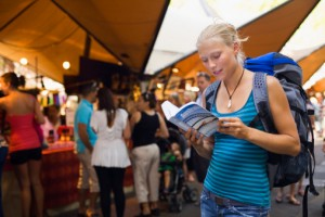 148938766-young-backpacker-checking-her-guidebook-in-gettyimages