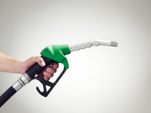 102416417-man-holding-a-petrol-pump-close-up-of-hand-gettyimages