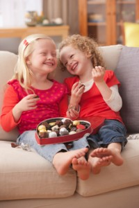 135538551-caucasian-girls-eating-valentines-candy-gettyimages