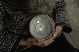 89039236-hangzhou-beggar-woman-holding-a-bowl-gettyimages
