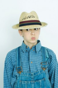 76152111-teen-girl-wearing-overalls-and-straw-hat-gettyimages