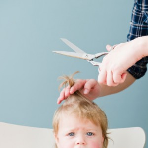 96827019-baby-girl-getting-haircut-gettyimages