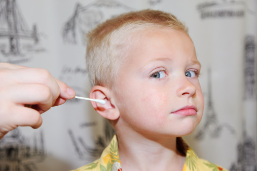 146582295 child having ear cleaned with cotton swab gettyimages