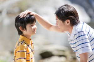 100372391-father-stroking-sons-head-gettyimages
