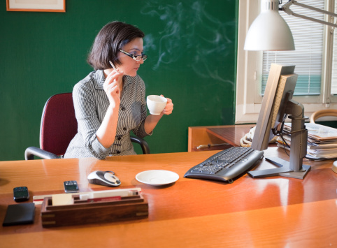 154966506-woman-smoking-at-work-gettyimages
