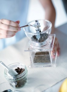 180401578-woman-grinding-coffee-bean-gettyimages