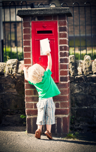 122400268-child-posting-letter-gettyimages